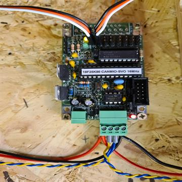CBUS CANMIO-SVO board with two servo leads attached and ready to be tested